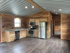 The Blue Water: a modular home with an open living room and a full kitchen with large windows to naturally illuminate the home. Built by Portable Buildings of Brenham. Tiny House Cabin, Tiny House Living, Tiny House Design, Living Room, Shed Cabin, Lofted Barn Cabin, Shed To Tiny House, Kitchen Living, Metal Building Homes