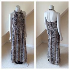 """NWT Jessica Simpson Halter Maxi NWT Jessica Simpson Halter Maxi...anaconda print chiffon high-neck halter...gun metal snap closure...banded elastic waist...side pockets...fully lined in black polyester/spandex blend...dry clean. Approx length 55"""" Retail $148 Jessica Simpson Dresses Maxi"""