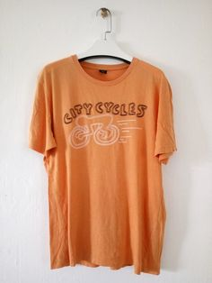 7d5eda000 Vintage KEITH HARING T shirt 90 s K.Haring City Cycle Pop Art Orange Colour  Medium Size