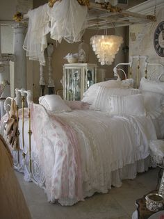 Pretty pink and white lace bedroom with ballet slippers...