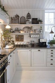 Open shelving. Like the concrete tops and comfortable country style. Cup handles are very nice I think!