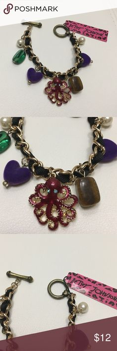 Betsey Johnson charm bracelet heart octopus pearl New with tags Betsey Johnson charm bracelet! Charms include a purple felt heart, a red octopus, and beads. Betsey Johnson Jewelry Bracelets