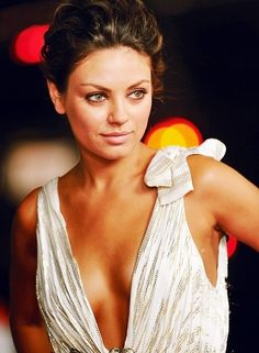 Mila Kunis.  She & Angelina need to be cast in something together.