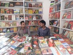 Book sellers in a book stall, all are books books n books around them 😍