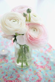 Frilly Ranunculus are the star here in this elegant little centerpiece. Shop Ranunculus and other popular wedding and wholesale flowers at GrowersBox.com!