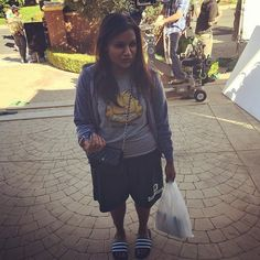 Pin for Later: 16 Amazing Mindy Kaling Outfits We're Shopping Right Off Her Feed Mindy's Garfield Graphic Tee . . . and Chanel Bag