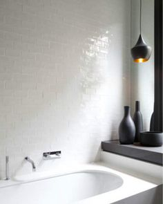 there is something about those white tiles that just do it for me, not to mention that pendant light
