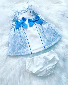 Baby Girls Dress Set with Knickers. Baby Blue with double Bow detail. Spring/Summer 2019. Sizes 6 months up to 10yrs. Matching older sister available too.