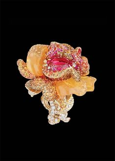 Le Bal des Roses collection calls to mind Christian Dior's magical ability to transform his beloved flowers into dresses for his couture collections and sumptuous gowns for the costume balls he so enjoyed. Left: the Bal Vénitien ring in yellow gold, diamonds, colored diamonds, pink spinel, fire opals, spessartite garnets, and pink sapphires. See more Dior jewelry: http://www.assouline.com/9781614280200.html