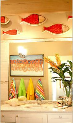 This bathroom is adorable...love the fish!  Great color.