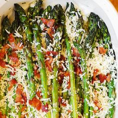 Asiago, Bacon, and Garlic Roasted Asparagus Recipe Side Dishes with asparagus, olive oil, salt, pepper, garlic cloves, asiago, bacon slices