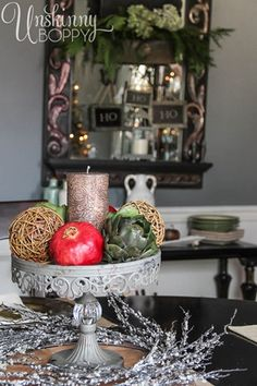 Holiday tablescape with pomegranates and artichokes