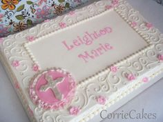 Baptism Cake 1/2 iced and partly decorated in BC with MMF blossoms and cross ruffle thingy.