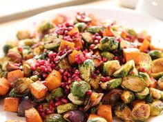 Beautiful Brussels Sprouts : Ree roasts Brussels sprouts and butternut squash with bold chili powder until they're golden and tender, then finishes the veggie mixture with tangy pomegranate molasses and fresh pomegranate seeds for vibrant results.