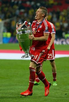 Bastian Schweinsteiger with the Champions League trophy. Glad he finally won it.