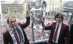 The Aston Villa manager Tony Barton, left, and captain Dennis Mortimer celebrate with the European Cup trophy.