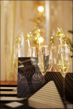 Champagne glasses rimmed w/ gold edible glitter