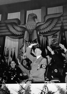 German Führer Adolf Hitler gives salute to all NSDAP members in attendance of a 1936 party rally.