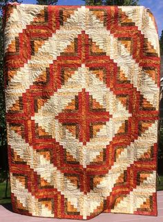 WOW. We love seeing what our customers have been up to! This fabulous quilter sent us a photo of her quilt which was made using our pre-cut kits. Four Timeless Tonga Batik Fireside Log Cabin quilt kits with a narrow coordinating batik sashing between the blocks to increase the quilt dimensions. Beautiful!  Post a picture of your quilt or sewing project that features Jordan Fabrics on our Facebook page to be entered into a quilt kit giveaway!  http://ss1.us/a/s9i1WqT9