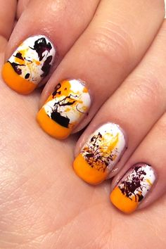 Yellow, black and whitesSplatter mani with French Tips!!!  Tres cool!!!