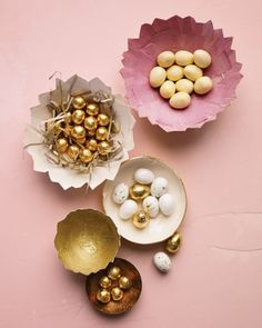"<9 of 42 >  Cracked Paper Eggshell Dishes  The ""cracked"" tops of papier-mache eggshells with pink, gold, and white linings become dishes for foil-wrapped chocolates and candy eggs. For the nest, decorative paper is cut with fringe scissors.  How to Make Papier-Mache Eggshell"