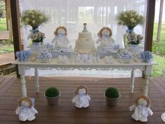 Baptism sweet table with food, flowers  and favor decorations