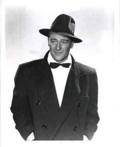 John Wayne in a bowtie coat and hat Premium Art Print