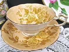 PARAGON-TEA-CUP-AND-SAUCER-TAN-PEACH-ROSE-PATTERN-WIDE-MOUTH-TEACUP