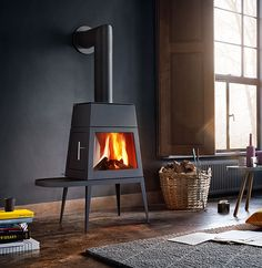 Skantherm Shaker small wood heater in an elegant interior #fireplace http://skantherm.com.au/