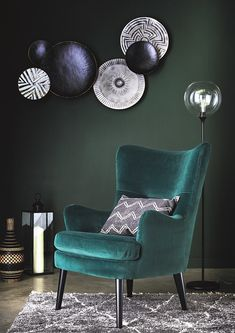 A contemporary piece with retro charm, the Marcy velvet chair in emerald green will give a fun update to any living area.