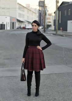 Gumboot Glam is ready for fall in our burgundy check pleated skirt. She pairs it with a chic black turtleneck and over-the-knee heeled boots. This versatile look is perfect for the office, a holiday party, or a night out   Banana Republic