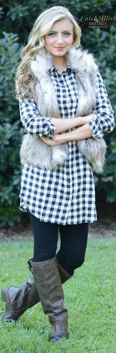 Classic fall fashion outfit. Must have faux fur vest paired with gingham print dress, leggings and boots. Free shipping on orders $50 and over!