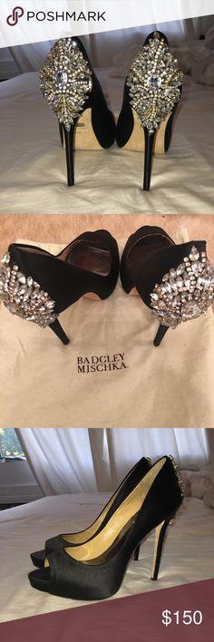 Badgley Mischka Kiara Embellished Platform Pumps Shimmering crystals accent the heel on these glamorous peep-toe Badgley Mischka pumps. Satin-covered platform and heel. Leather sole. Heel height- 5 inch. Badgley Mischka Shoes Heels