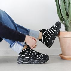 """UPTEMPO! The amazing Nike Air More Uptempo is a popular basketball sneaker that debuted in 1996. The """"AIR"""" lettering draws inspiration from oversized objects from '90's graffiti and pop art. It was designed by Wilson Smith and made famous by Scottie Pippen in the late '90s. Available now! #SupplyingGirlsWithSneakers"""