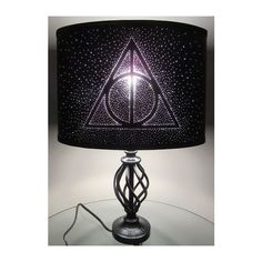 Harry Potter Deathly Hallows Pin Hole Lamp Shade ❤ liked on Polyvore featuring home, lighting, black lamp, black shades, black shade, light bulb shades and black lights