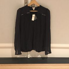 """Anthropologie navy blue top This is a NWT navy blue shirt from anthropologie. The brand is """"Tiny"""". Anthropologie Tops Blouses"""