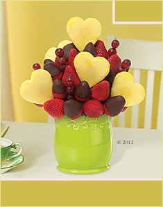 Love is in full bloom with this beautiful fruit arrangement! The Blooming Hearts™ fruit bouquet with Dipped Strawberries features our signature pineapple hearts and gourmet semisweet chocolate dipped strawberries, plus fresh strawberries and juicy grapes.