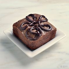 blackout :Packed with bittersweet, semi-sweet and milk chocolate chunks, this ultra-rich, ultra-chocolaty brownie is topped with an ultra-ebony, rich chocolate frosting.: Brownies by Beverly Hills Brownie Company