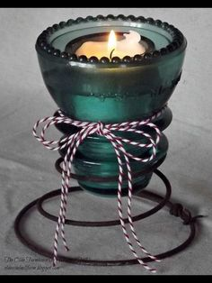 Insulators and old springs...candle holder
