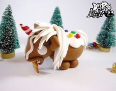 Handmade with the utmost care and attention to detail, made with premium polymer clay! Adorable Gingerbread Unicorn eating a gingerbread man!5cm TallPostage is £3 in the UK and £5 everywhere else no matter how many you want to buy!