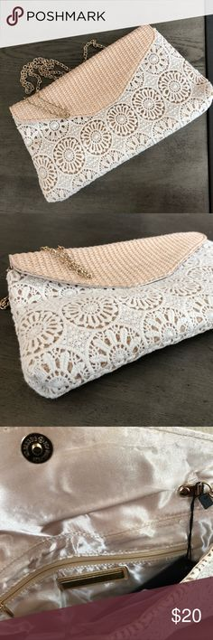 "New with tags Super cute crochet-lacey-like Clutch Dimensions : 11"" x 6.5"" x 1""   Perfect for any casually cute occasion from brunches to Baby showers!   Color: ivory with light beige flap. Street Level Bags Clutches & Wristlets"