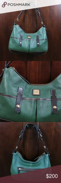 Dooney & Bourke  Hunter Green Satchel Style Purse Hunter green purse with chocolate brown trim, 10x14x3 This gorgeous purse is in perfect condition except the lining has some ink stains. My friend carried it maybe 3 times. Dooney & Bourke Bags Satchels