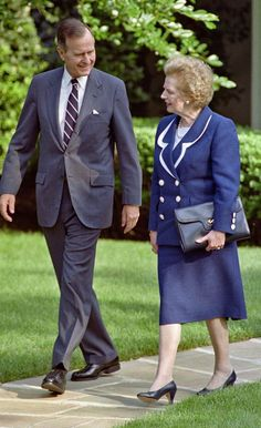 A picture dated June 20, 1991 shows US President George Bush walking with former British Prime Minister Margaret Thatcher