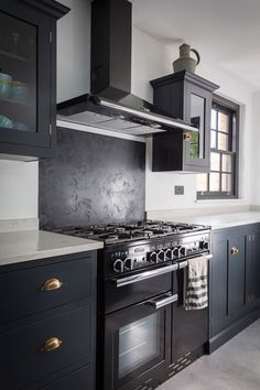 Finally! Ink blue cabinets, white marble worktops and black rangemaster with matching hood and splashback ❤