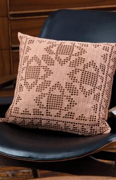 Quilt Block Filet Pillow - Interest in filet crochet is on the rise. This contemporary, quilt-inspired pillow makes good use of the filet technique.