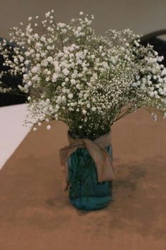 Centerpiece for boy baby shower..could not get blue jars so used blue food color in water...looks just as good