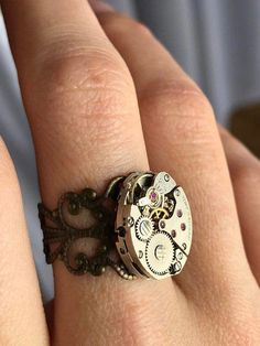 Our impressive custom handmade diamond wedding ring set, from Camellia Jewelry, will take her breath away. Custom handcrafted in the finest details, this unique engagement ring set features a carat round cut n Style Steampunk, Steampunk Rings, Steampunk Wedding, Gear Ring, Steampunk Accessories, Ring Watch, Ring Set, Diamond Cluster Ring, Filigree Ring