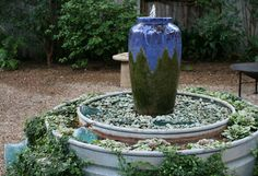 A New Kind of Raised Planter | stock tank trough planter and water feature