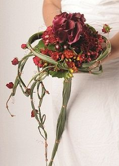 Freezia, black cherries, baby roses, hypericum, mini calla, galax leaves. Wrapped with a foliage structure, cascading down the bride's wrist - Beirut's Wedding Folies 2012: Latest Bouquet Trends! - Flowers - Tips