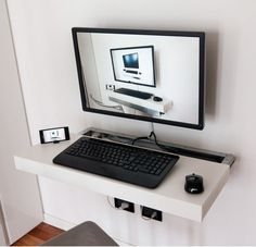 Sliding and Floating Mini PC Desk, very cool. Just use a bracket for a regular tv and any piece of wood or shelf really...if you use the kind with hooks on the bottom, you can keep important things hanging around/close by as well.